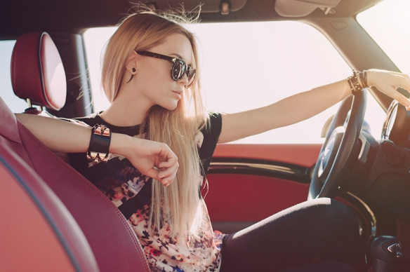 Blondie young girl at the wheel of sport car